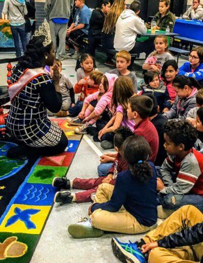 Miss Liberia talking to kids