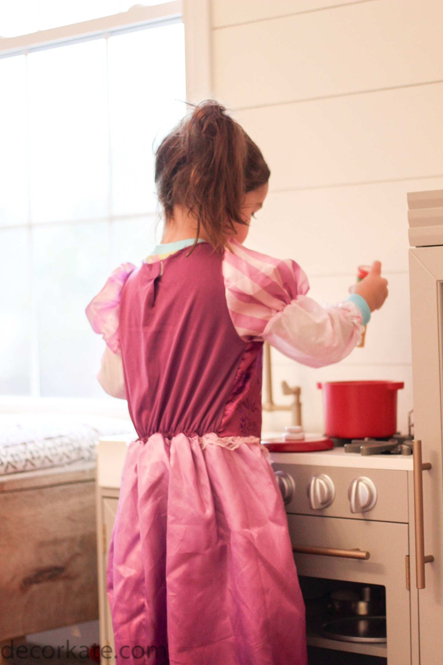 girl playing in kitchen