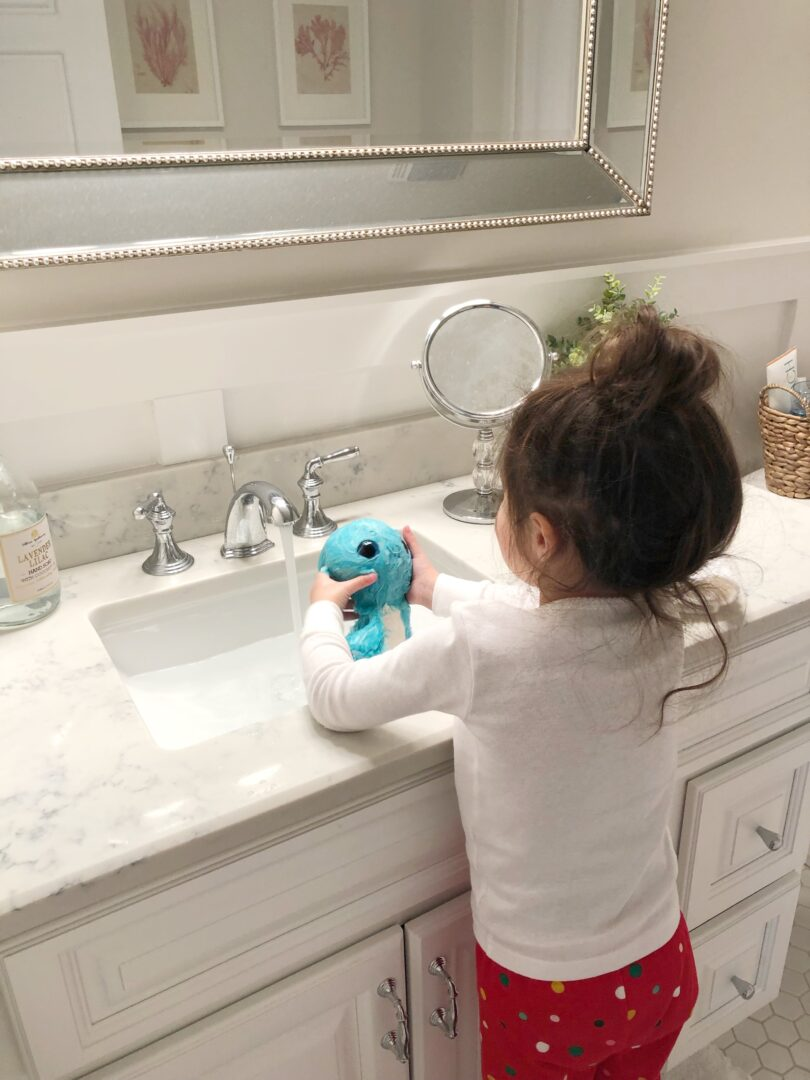 quartz counters child in bathroom