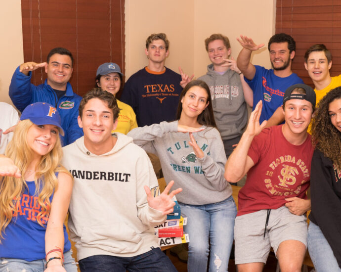 students wearing shirts from their favorite colleges