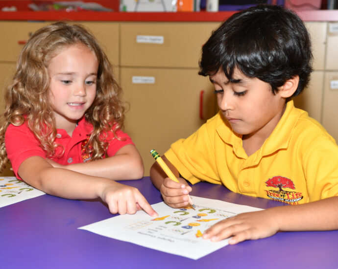 A boy and girl learning together
