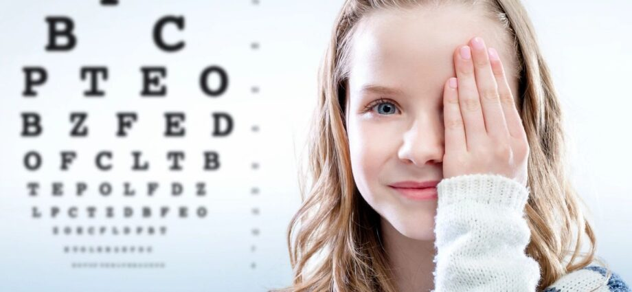 Girl taking eye test, with on eye covered
