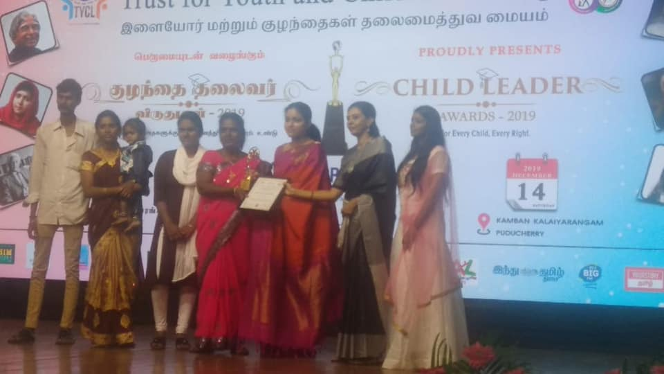 Arunodhaya women sangam leader Ms Loganayagi received the family award at the child leader award function