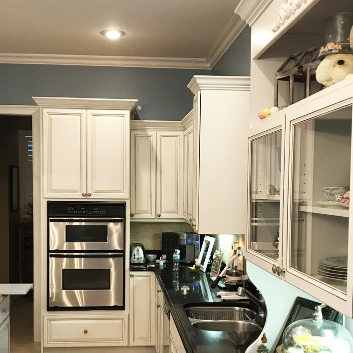 Complete cabinet refacing makes this kitchen bright and modern again!