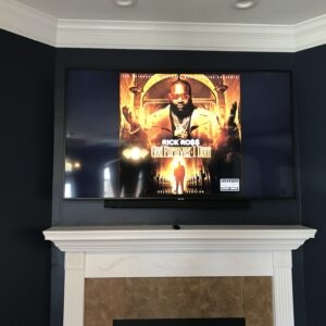 TV Mounted over Fireplace Mantel