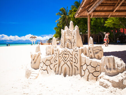 Sand castle on a white tropical sandy beach