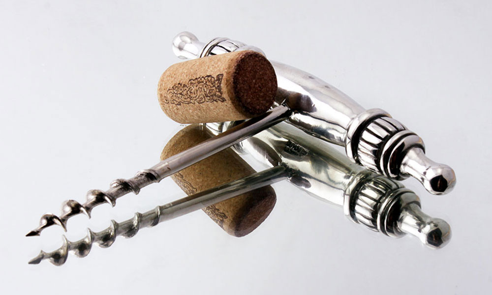 Picture of wine corkscrew on glass surface