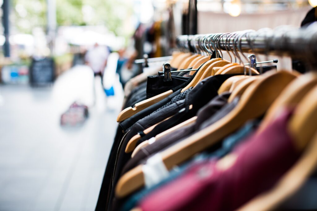 photo of clothes rack sidewalk sale