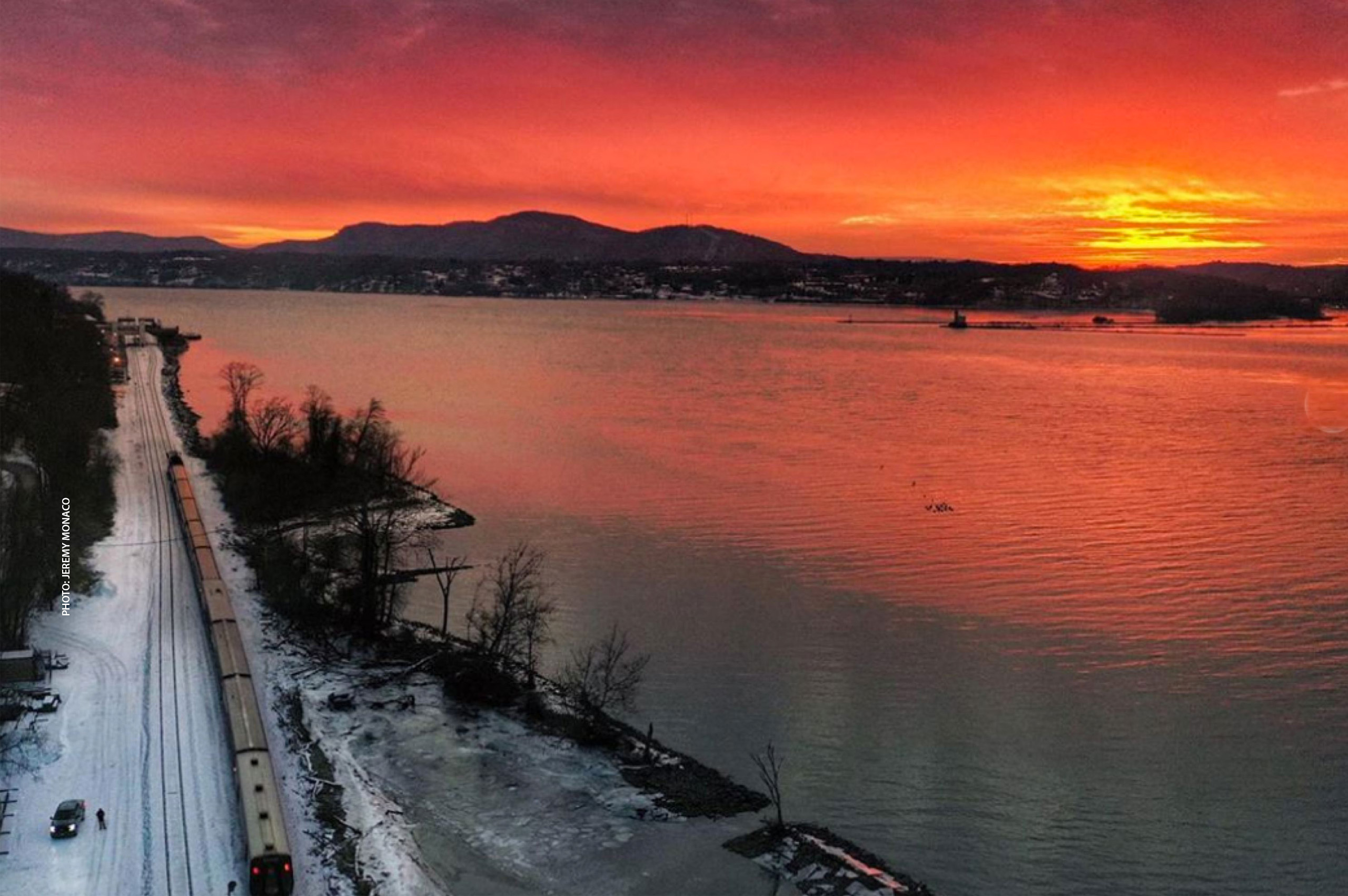 photo of sunset over Hudson River with Train