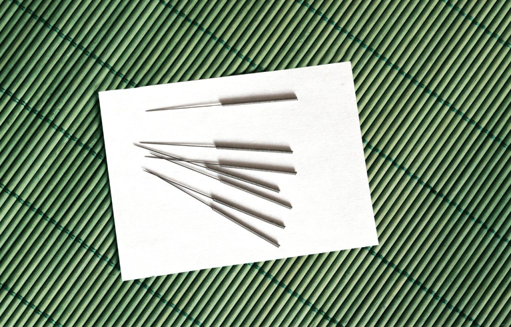 stainless steel acupuncture needles on table