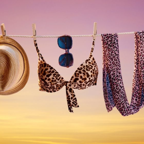 sunset beach with hat and scarf on string to dry