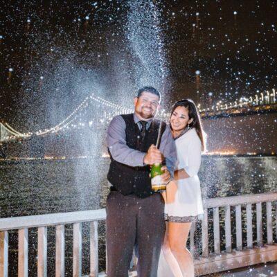Wedding couple in the rain by Andrea De Anda in Santa Cruz, CA