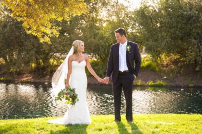 Wedding couple standing in front of lake in Avila Beach, CA