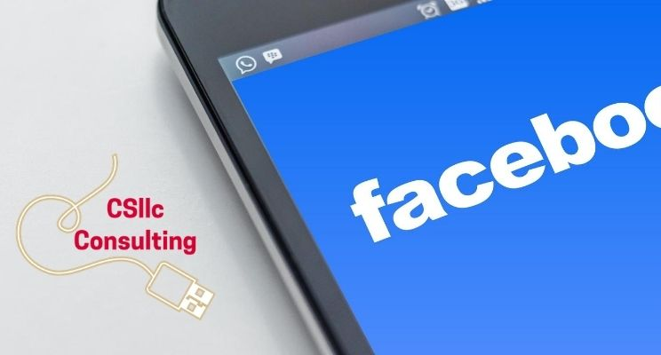 photo of phone with Facebook graphic on the screen