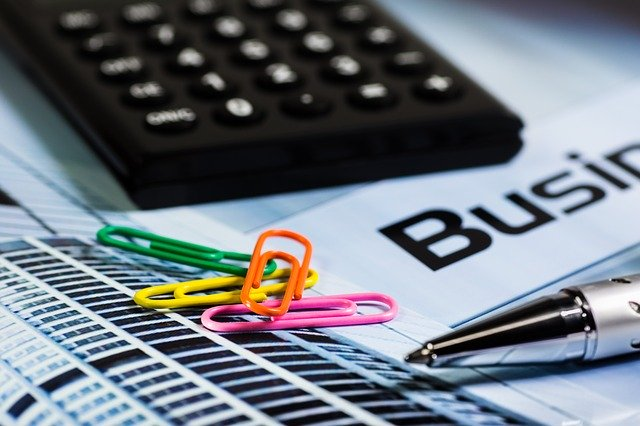 photo of calculator and paper clips used to illustrate writing a Business Plan video