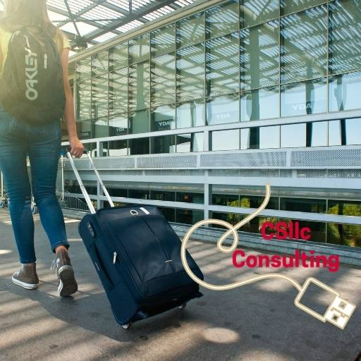 photo of woman pulling a rolling suitcase