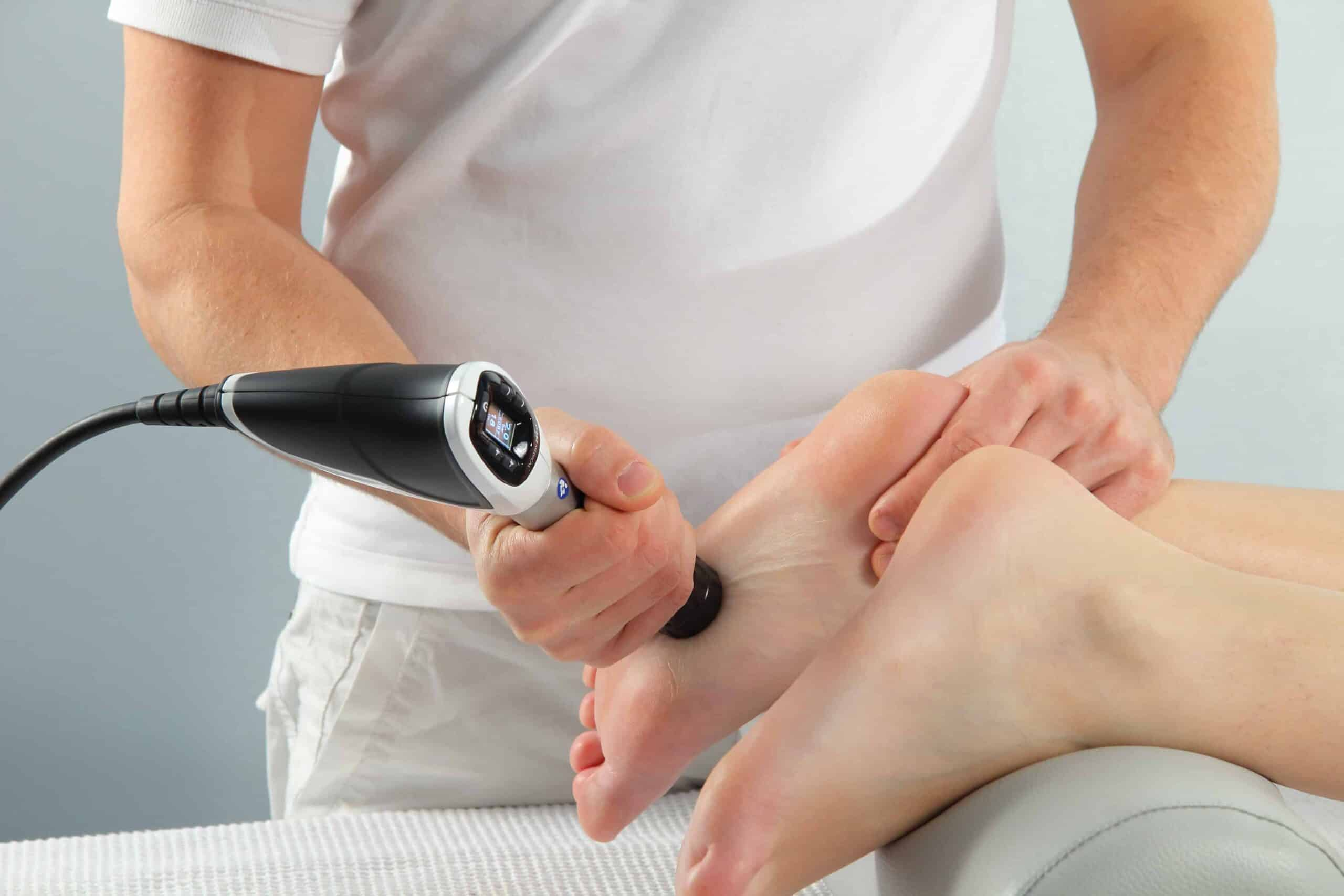 Doctor operate patient knee with machine