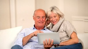 stock-footage-senior-couple-surfing-on-internet-with-touchpad