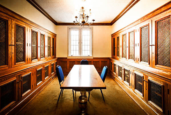 small library with conference table and chandelier