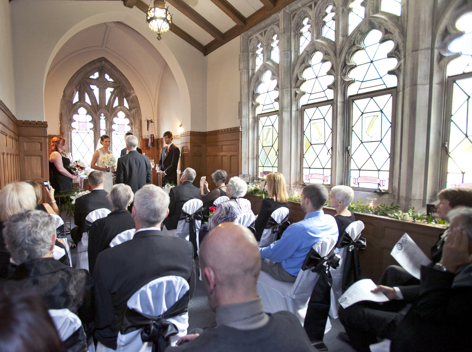 small chapel with bride and groom and 20 guests