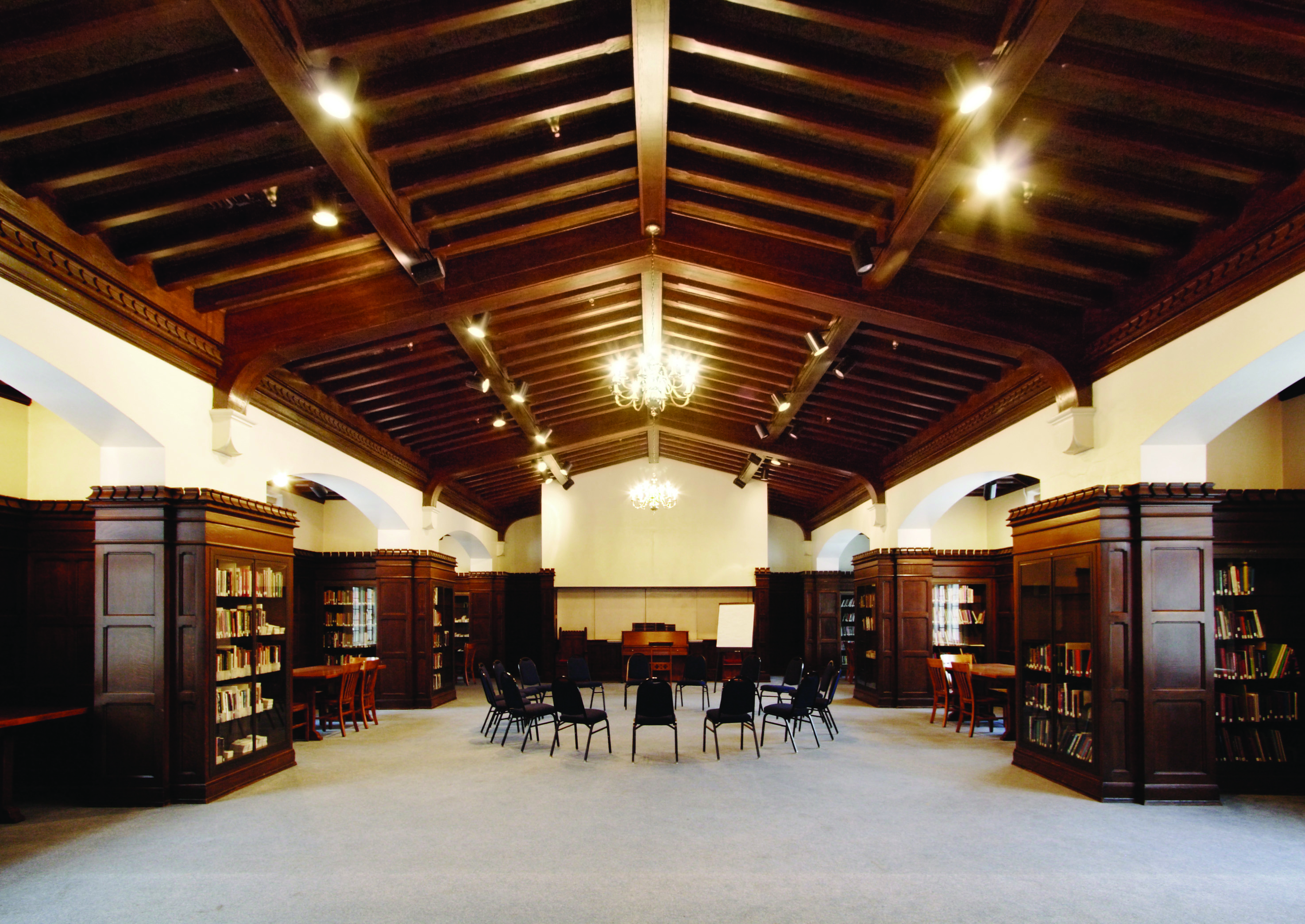 meeting room with high ceilings and dark wood paneling