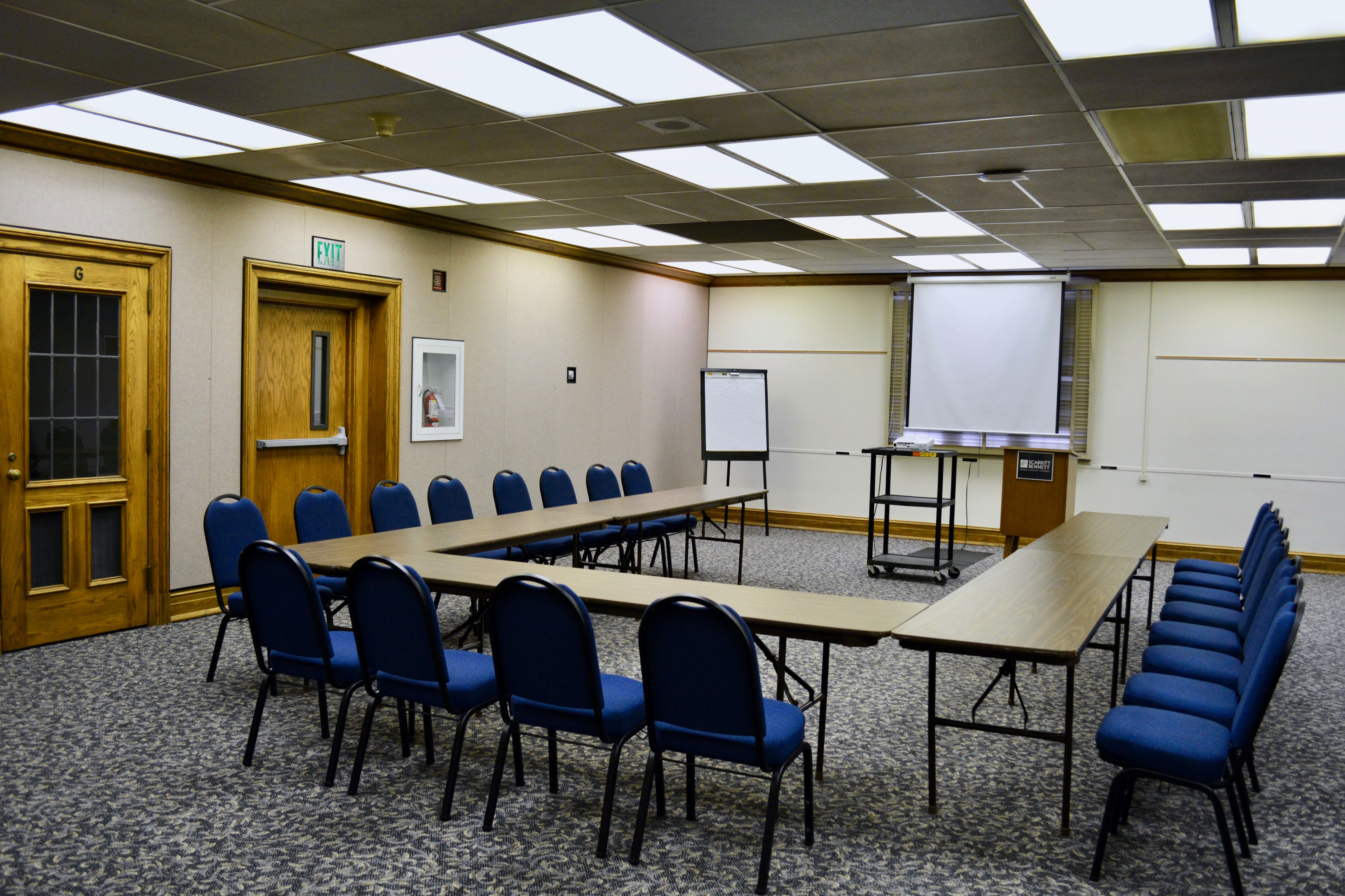 Medium sized room with tables and chairs in u-shape