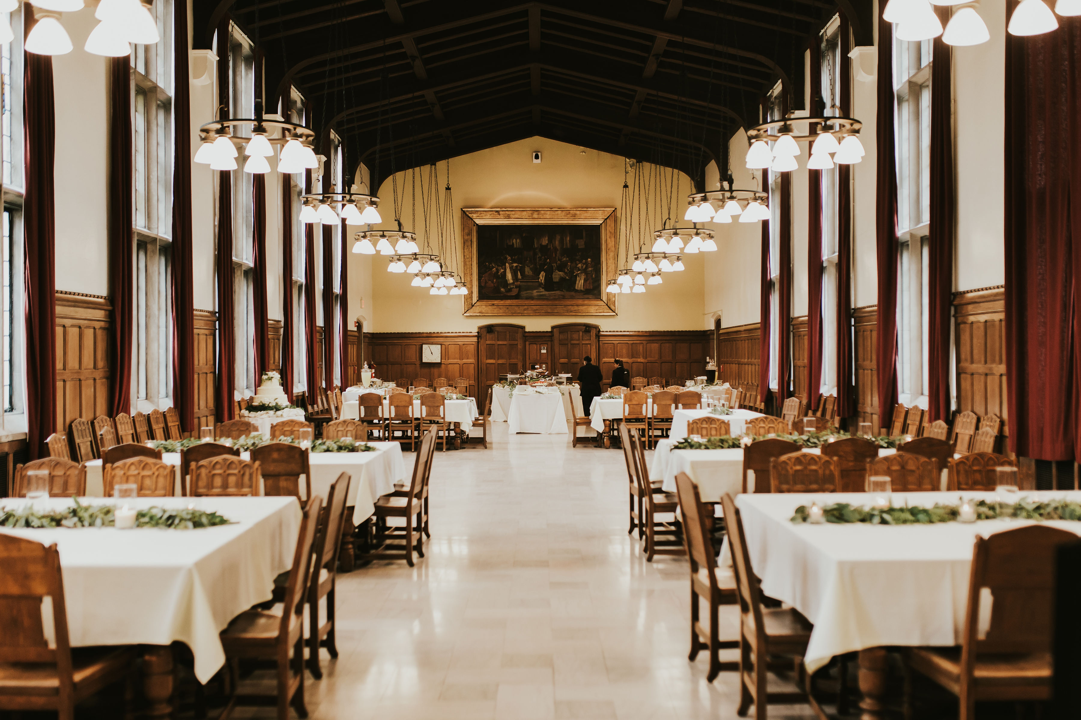 decorating dining hall with banquet tables and flowers