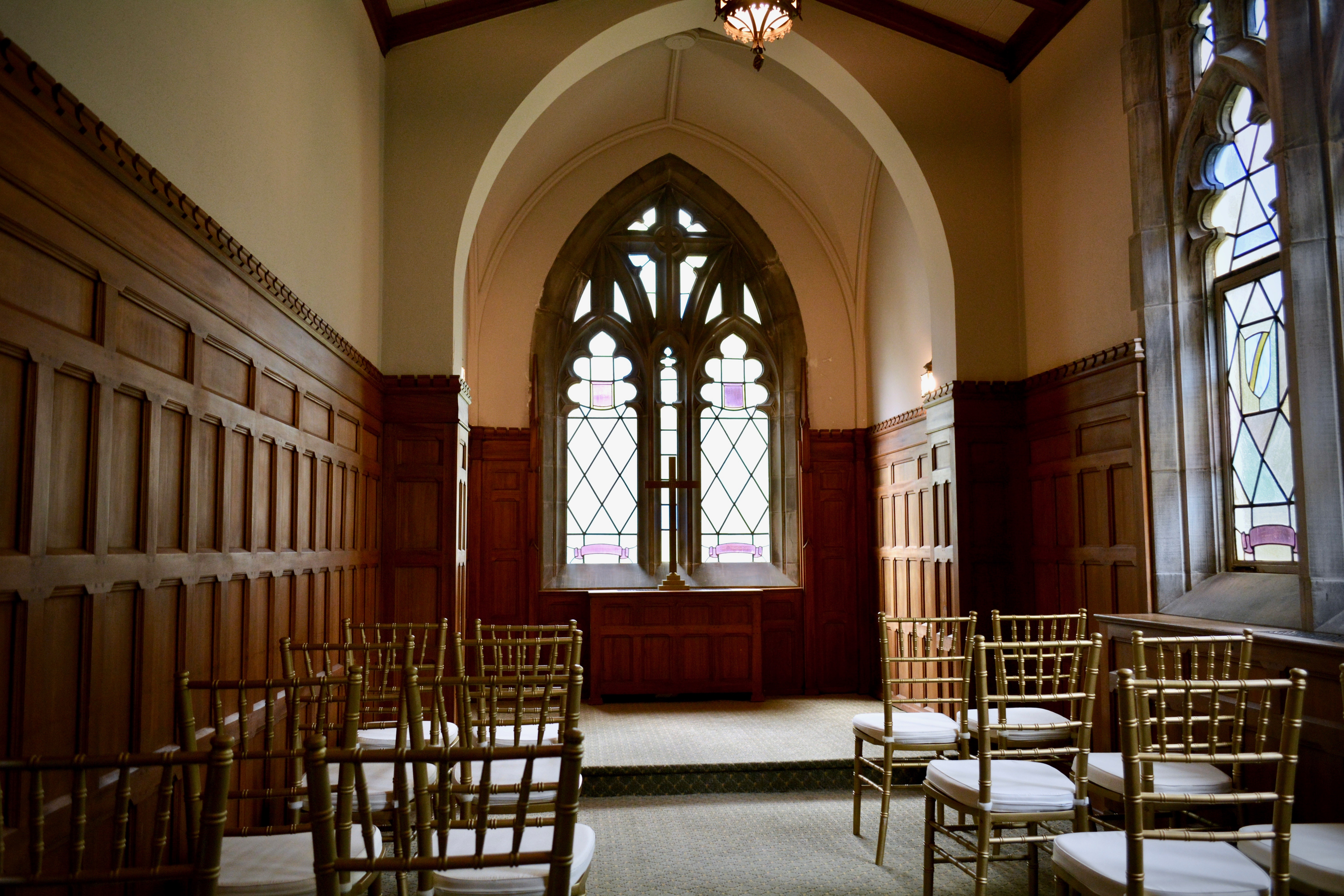 small chapel with 20 chairs and small altar table