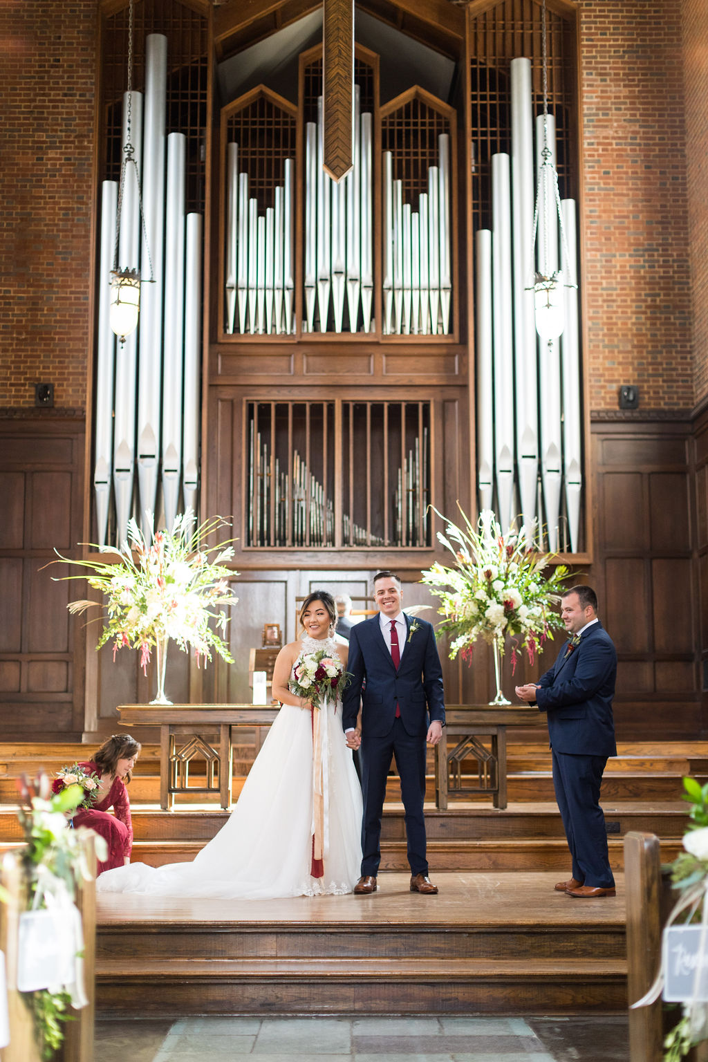 Couple standard at the altar in Wightman, smiling toward guests