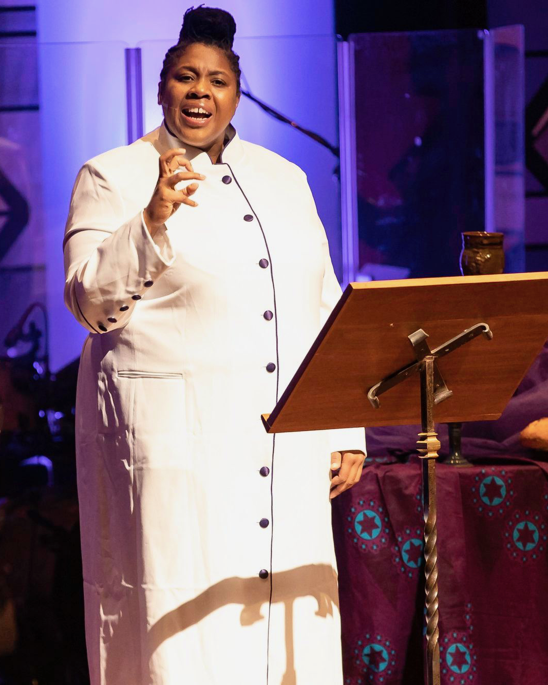 woman standing at podium during a worship service
