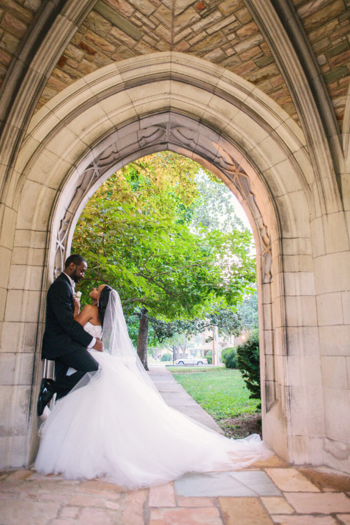 Couple embracing under stone archway