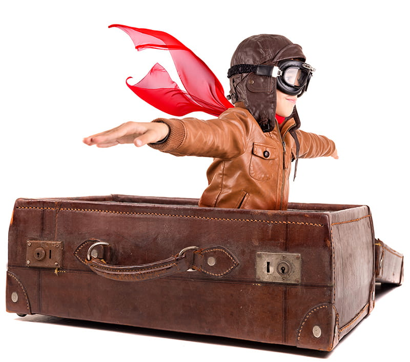 Boy Playing Pilot in Suitcase