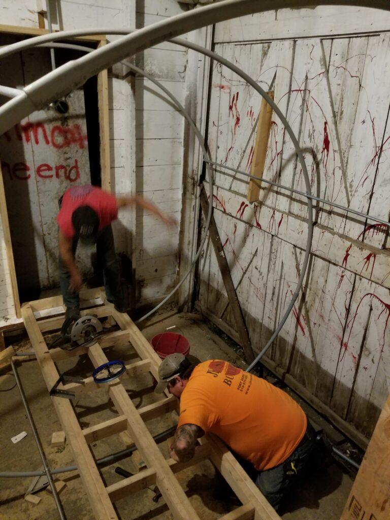 Volunteers building the vortex tunnel.