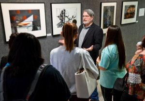 Sept. 3, 2016 LES HASSELL/NEWS-JOURNAL PHOTO Photographer and Kilgore College instructor O. Rufus Lovett talks to students recently about his work on display at the Ann Dean Turk Fine Arts Center.