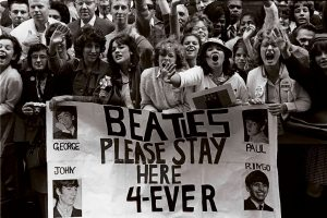The arrival of the Beatles changed the lives of American girls, shown here at the Paramount Theater in New York later in 1964. Credit Jack Manning/The New York Times