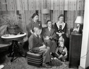 """March 1943. Rochester, New York. """"The Babcocks, an American family, tuning in for war news. Mr. and Mrs. Babcock with children Shirley, Howard and Earl, the youngest."""" Photo by Ralph Amdursky, Office of War Information."""
