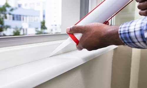 Applying Caulk to Window