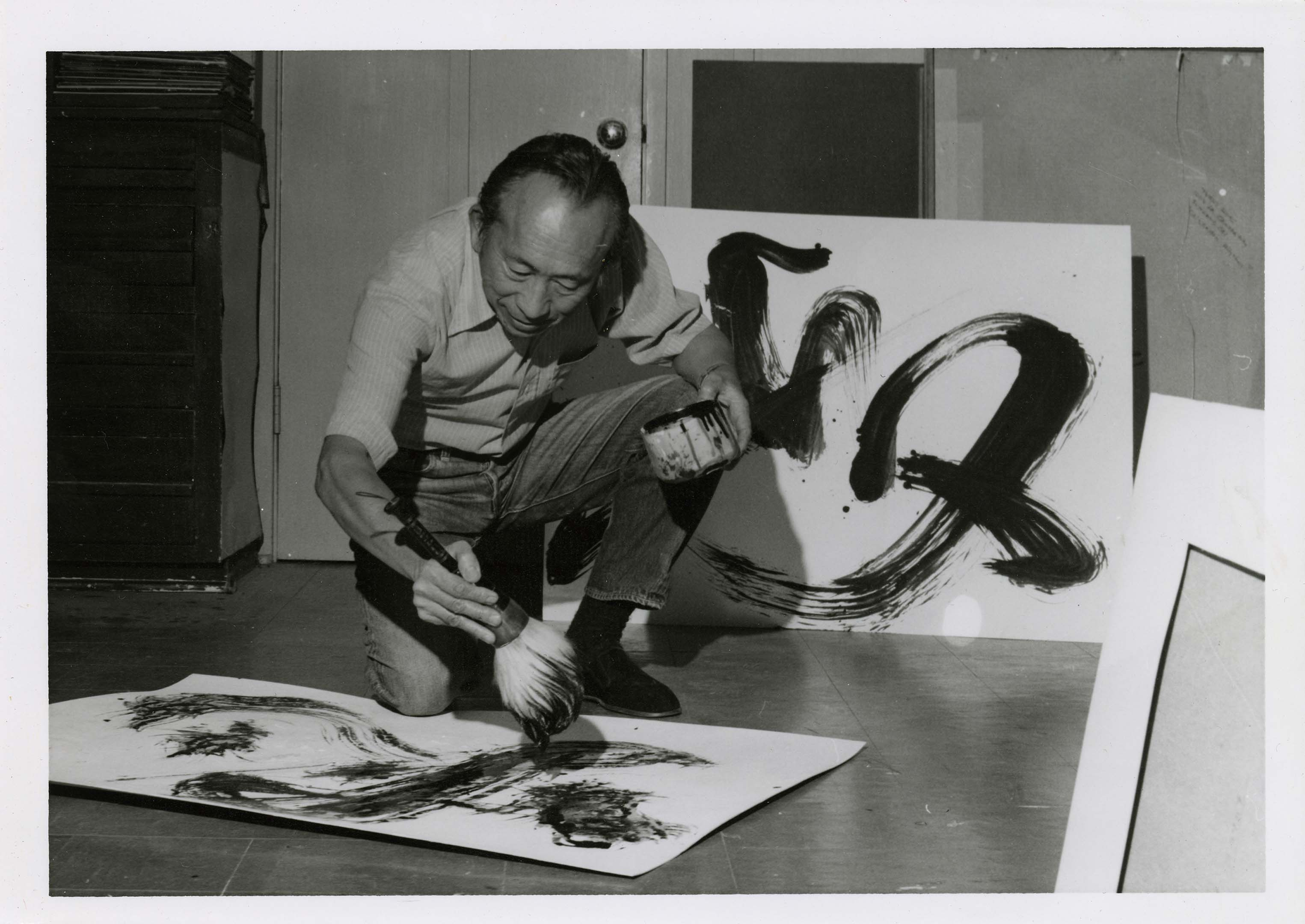 Tyrus Wong works on a calligraphic painting. Courtesy the Tyrus Wong Family.