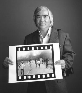 """Pulitzer Prize-winning photographer Nick Ut holding his photo of the """"Napalm Girl.""""   Courtesy Nick Ut"""