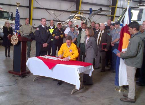 Gov signing legislation for new fire fighting aircraft.