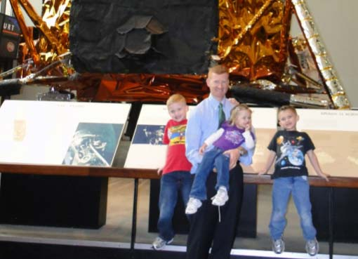 With the kids in front of the lunar module (LEM).