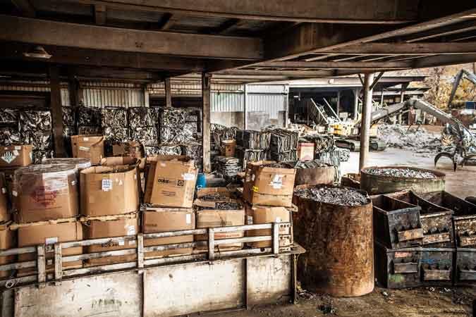 warehouse-barrels-of-scrap-material