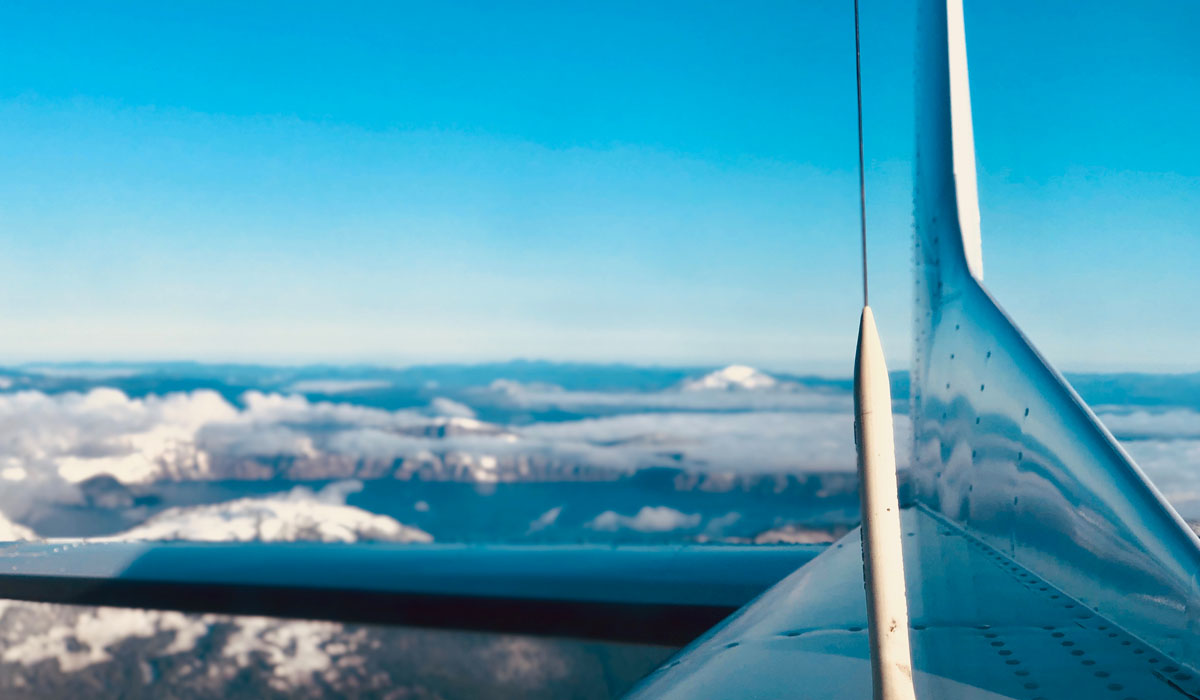 View from Precision Aviation training plane flying over mountains in the Pacific Northwest