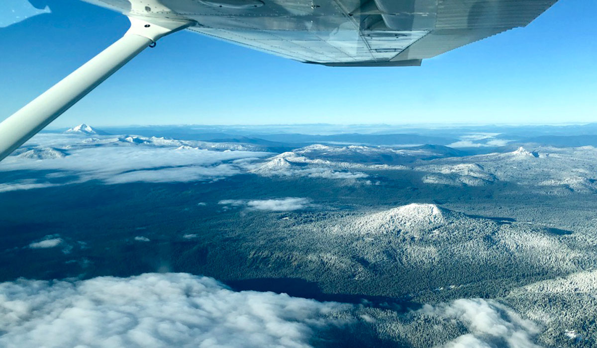 View of Pacific Northwest mountains from Precision Aviation training plane