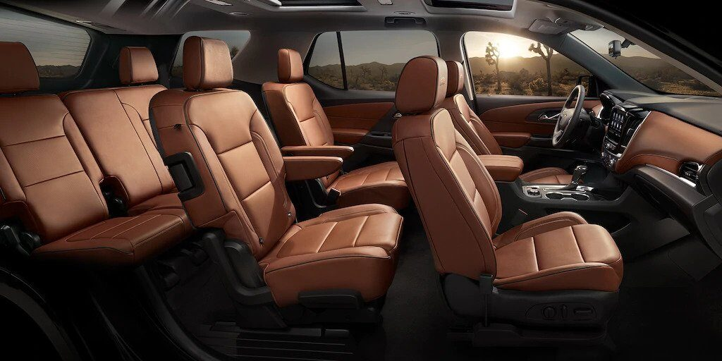 2020 Chevy Traverse Brown Leather Interior - Cabin View With All 3 Rows of Seats (7 passengers/Captain Chairs)