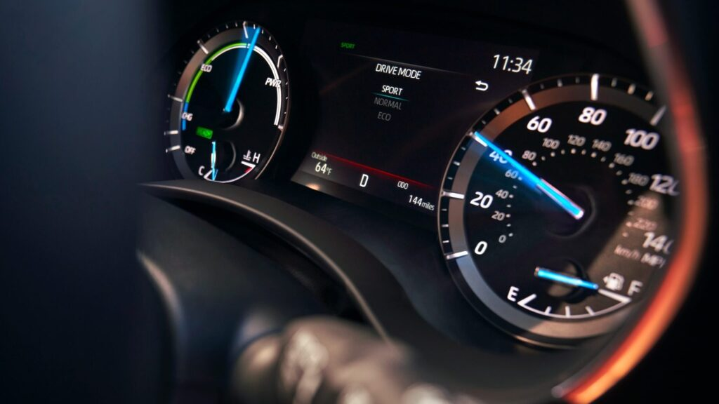 2020 Toyota Highlander Hybrid gauge cluster (driving in sport mode)  BEST Road-Trip Cars of 2020