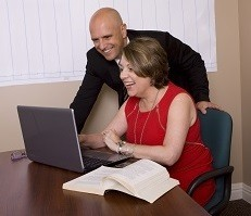 Maureen Farmer helping an executive with his career advancement strategy