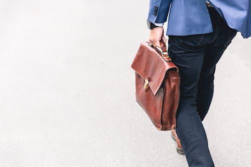 Executive carrying briefcase