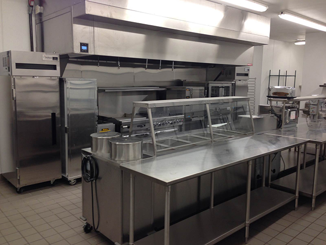 Stainless steel industrial prep kitchen at Arcadia Senior Living