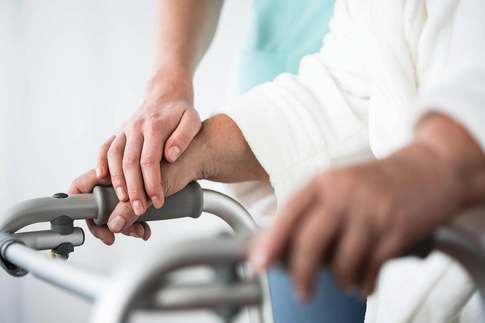 helping hand to senior using a walker